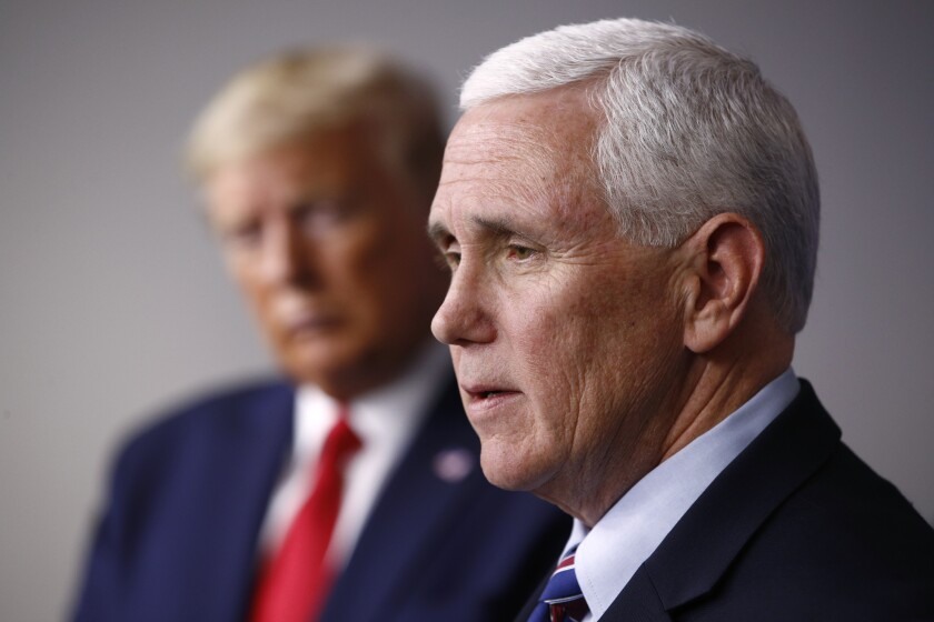 """FILE - In this March 22, 2020, file photo Vice President Mike Pence speaks alongside President Donald Trump during a coronavirus task force briefing at the White House in Washington. Pence says the U.S. response to the coronavirus pandemic is """"a cause for celebration,"""" but a new poll finds more than half of Americans calling it fair or poor. (AP Photo/Patrick Semansky, File)"""