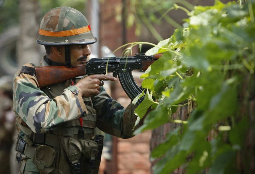 An Indian army soldier holds an AK-47 assault rifle during a fight in the town of Dinanagar, in the northern state of Punjab, India, Monday, July 27, 2015. Indian army commandos joined police in fighting suspected militants who fired at a bus station and stormed into police barracks on the outskirts of a northern town bordering Pakistan early Monday. Rebels have been fighting for an independent Kashmir or its merger with Pakistan since 1989. (AP Photo/ Channi Anand)