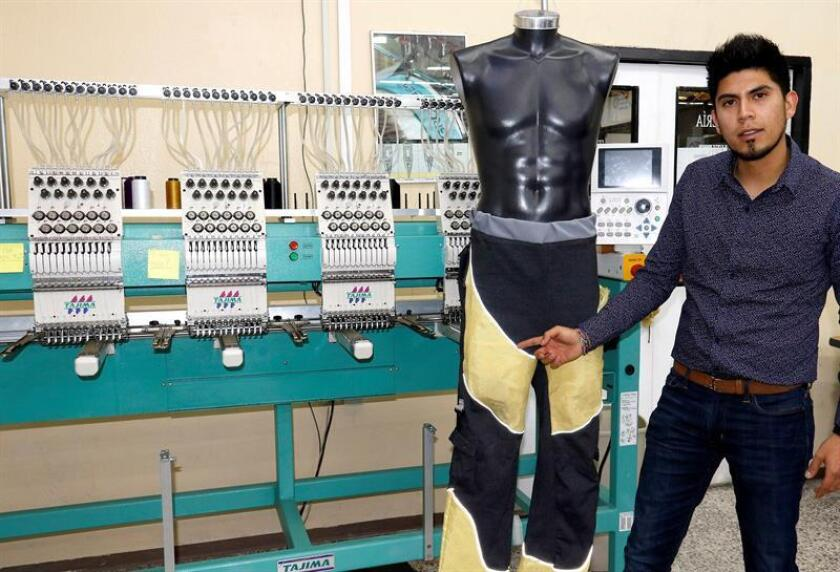 Photo provided by Mexico's National Polytechnic Institute showing Foed Alejandro Vivanco Lopez posing by a pair of orthopedic pants he designed for paraplegics. EFE-EPA/IPN/Editorial Use Only/No Sales