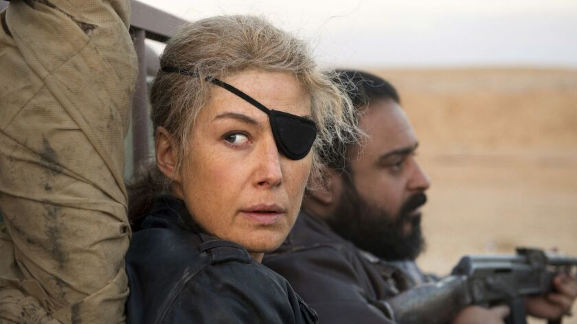 "This image released by Aviron shows Rosamund Pike in a scene from ""A Private War."" On Thursday, Dec."