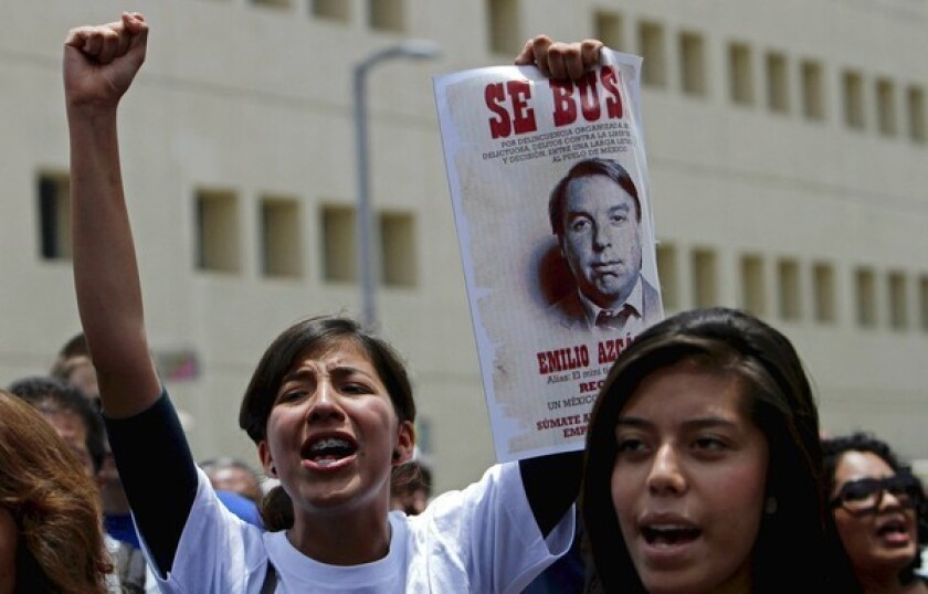 University students who are members of the Yo Soy 132 movement chant slogans at a protest in Mexico City in July.