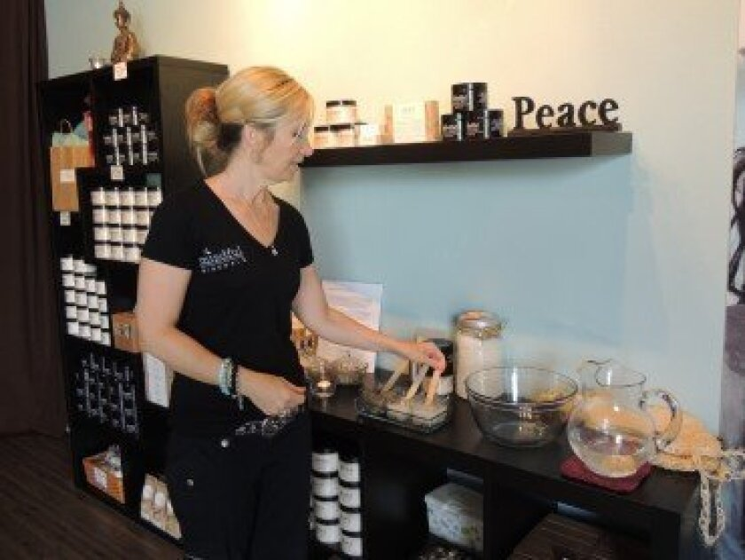 Amy Cameron straightens the salt hand scrub station at her new Salt Room in La Jolla at 7509 Draper Ave.