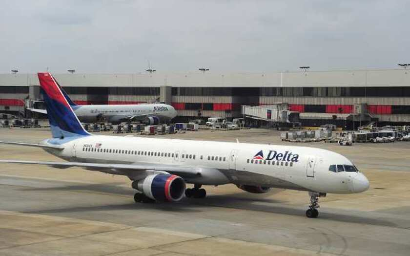 A Delta Airlines jets arrives at Atlanta-Hartsfield International Airport. Passengers on two Atlanta-bound Delta flights over the weekend discovered sewing needles in sandwiches served by the airline.