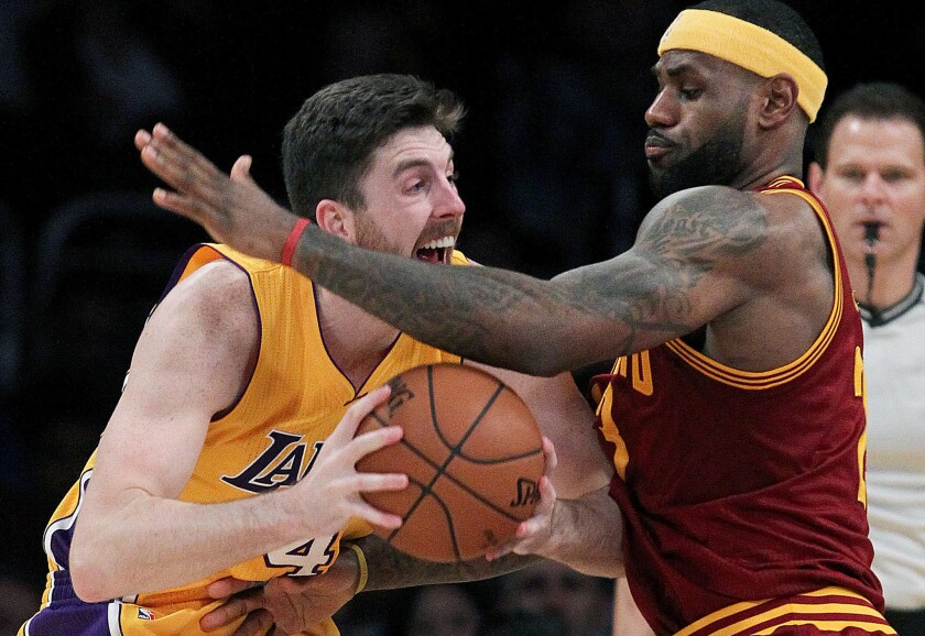 Lakers forward Ryan Kelly looks for room to maneuver against Cleveland's LeBron James on Jan. 15.