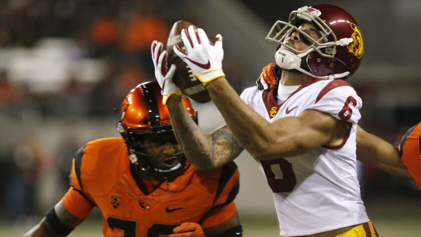 USC's Michael Pittman Jr. can't hold onto a pass while being guarded by Oregon State's Jalen Moore in the first half on Saturday.