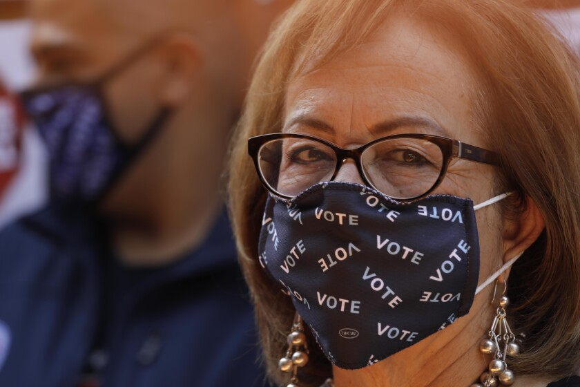 """Sen. Maria Elena Durazo (D-Los Angeles) wears a face mask that says """"VOTE"""""""