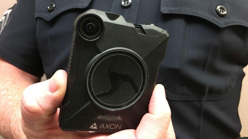 An El Cajon police sergeant displays a body-worn camera.