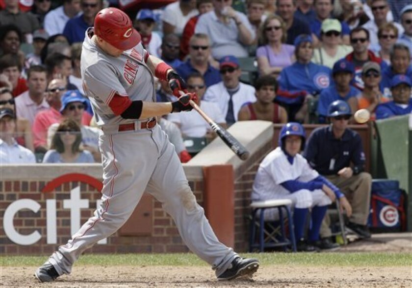 Cincinnati Reds' Todd Frazier hits a two-run single against the Chicago Cubs during the sixth inning of a baseball game in Chicago, Friday, Aug. 10, 2012. (AP Photo/Nam Y. Huh)