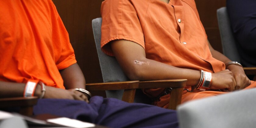 Shaquille Jordan, left, and Rashon Abernathy, right, during their preliminary hearing before Superior Court Judge Joan P. Weber. The judge ordered the media to not show the defendants' faces.