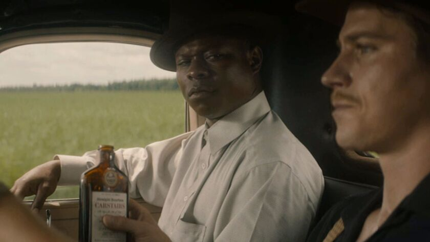 "(L-R) - Jason Mitchell and Garrett Hedlund in a scene from the movie ""Mudbound."" Credit: Netflix"