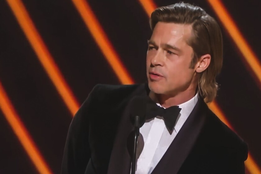 Brad Pitt accepts his award for supporting actor at the 92nd Academy Awards ceremony in Los Angeles.