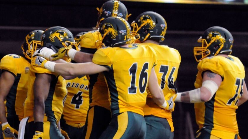 North Dakota State players celebrate a touchdown during a game against Sam Houston State on Dec. 15, 2017.