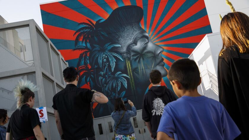 LOS ANGELES, CALIF. -- FRIDAY, MAY 27, 2016: Visitors flock to the mural made by Beau Stanton at a t