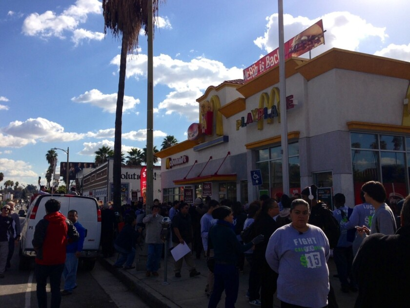 Workers, union organizers and supporters protest for higher wages outside a McDonald's in Silver Lake.