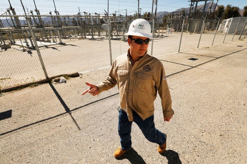 SDG&E engineer Steven Prsha walks past a substation next door to the utility's microgrid in Borrego Springs, in the desert of eastern San Diego County.