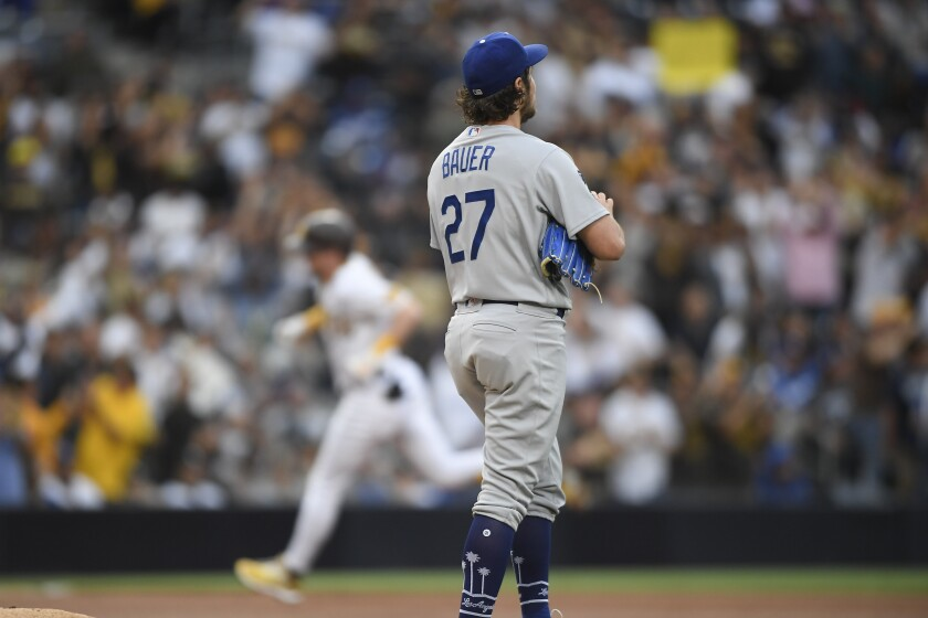 Dodgers pitcher Trevor Bauer stands on the mound after giving up a home run to San Diego Padres' Jake Cronenworth.
