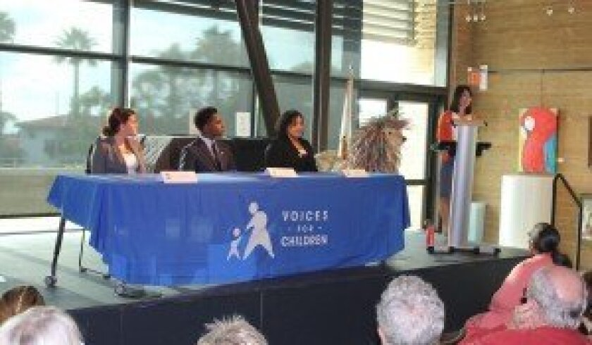 Current and former foster children spoke about the effect their court-appointed special advocates had on their lives at the Aug. 7 event held at the Encinitas Library. Photo by Joe Tash.