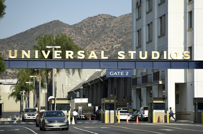 """FILE - In this Aug. 23, 2016 file photo, the entrance to the Universal Studios lot is pictured in Universal City, Calif. A film built around the premise of liberal """"elites"""" hunting people for sport in red states is coming to theaters in March, and the studio behind it is leaning into controversy about its premise. Universal Pictures on Tuesday, Feb. 11, 2020, unveiled a trailer announcing """"The Hunt"""" will be released March 13, roughly six months after it was supposed to have been released. (Photo by Chris Pizzello/Invision/AP, File)"""