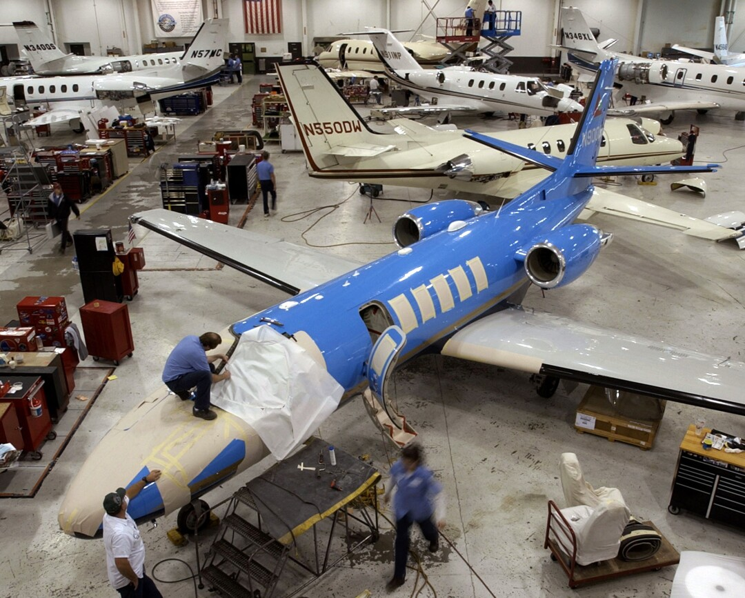 Workers service Cessna Citation business jets at Cessna's service center in Wichita, Kansas.