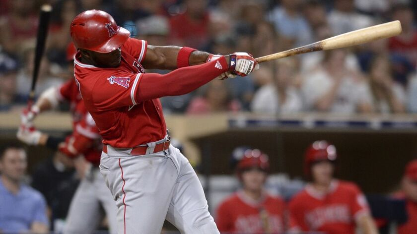Angels' Justin Upton hits a two-run home run during the fifth inning of a baseball game against the San Diego Padres in San Diego.