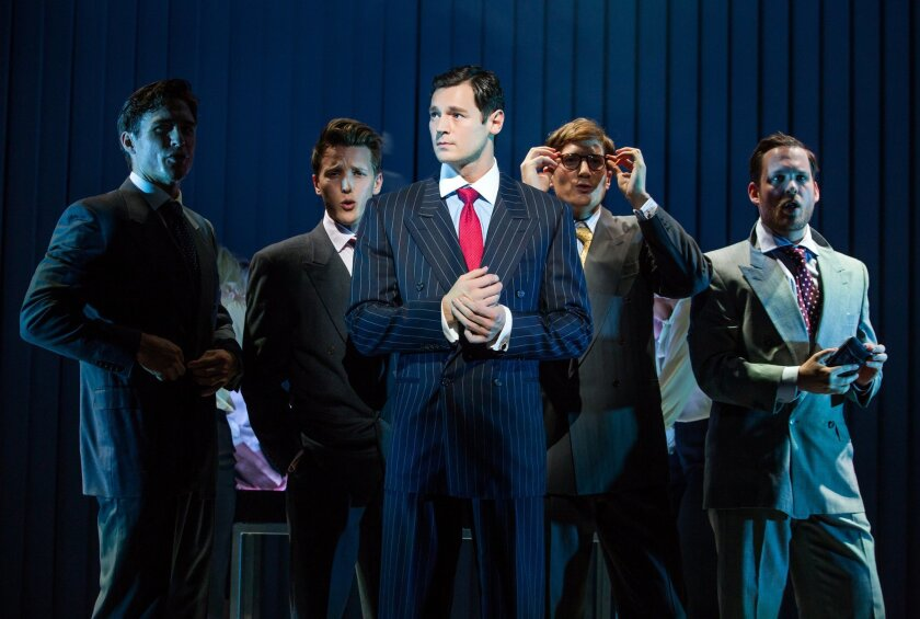 """This image released by Jeffrey Richards Associates shows Benjamin Walker, center, and the cast during a performance of """"American Psycho,"""" opening at the Gerald Schoenfeld Theatre in New York. Producers of the adaptation of the once-controversial novel by Bret Easton Ellis said Thursday will close J"""