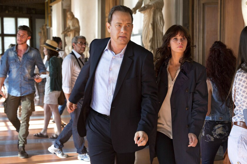 """Tom Hanks, left, and Felicity Jones in a scene from director Ron Howard's """"Inferno."""" (Jonathan Prime/Sony Pictures via AP)"""