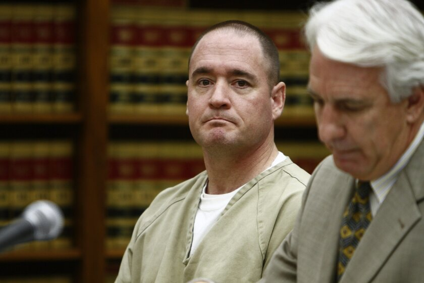Former Navy SEAL Jason Mullaney (left) listened as experts testified in his criminal case.