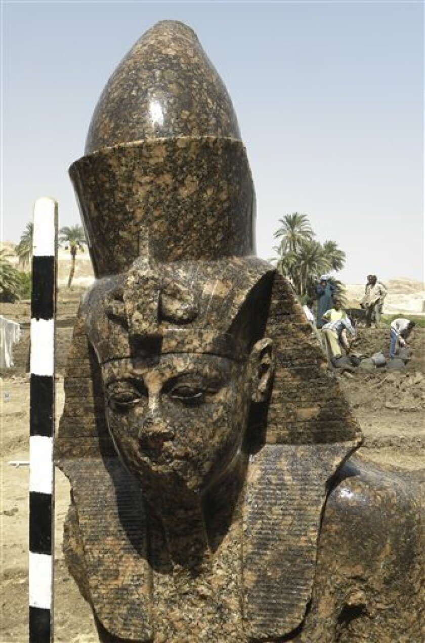 In this undated hand out picture released, Saturday, Oct.2, 2010, by Egypt's superme council of antiquities, the unearthed double limestone statue of Ahmenhotep III, one of the most powerful pharaohs, who ruled nearly 3,400 years ago, was discovered in Kom el-Hittan, the site of the temple of Amenhotep III. The temple is one of the largest in the southern temple city of Luxor. (AP Photo/ Supreme Council of Antiquities, HO)