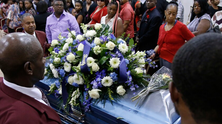 The casket of Terence Crutcher, who was fatally shot by a police officer, is wheeled out of the church following funeral services in Tulsa, Okla., on Saturday.