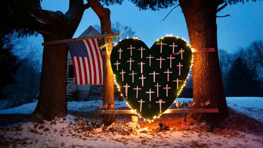 A memorial with crosses for the victims of the Sandy Hook Elementary School massacre stands outside a home on Dec. 14, 2013, the first anniversary of the tragedy in Newtown, Conn.