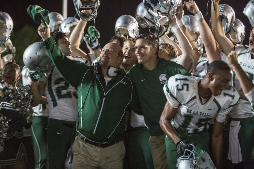 """Jim Caviezel, Alexander Ludwig and Michael Chiklis in the movie """"When the Game Stands Tall."""""""