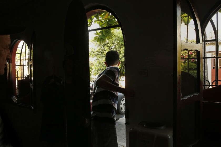 In El Salvador, Mauricio Gomez was living in fear, separated from his parents in the U.S.