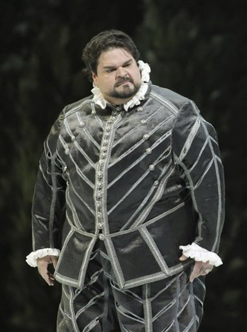 """In this photo released by La Scala theater, U.S. tenor Stuart Neill performs Giuseppe Verdi's opera Don Carlo in Milan's La Scala theater, Italy, Sunday Dec. 7, 2008. The famed La Scala opera house has long been known for its behind-the-scenes intrigues, with strikes, personality disputes and artistic differences often eclipsing its performances. Sunday's opening night was no exception. La Scala unexpectedly removed Italian tenor Giuseppe Filianoti from the leading role of """"Don Carlo"""" and put American tenor Stuart Neill in his place. (AP Photo/Teatro La Scala, HO)"""