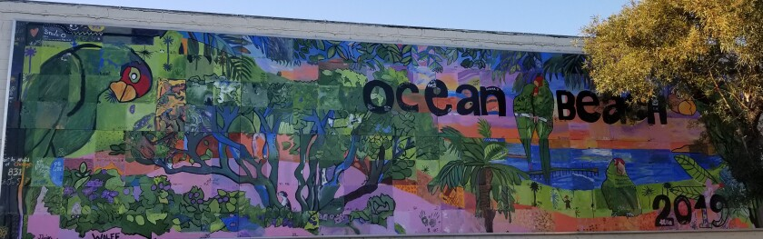 The 2019 mural depicts OB's famous parrots. Find it on a back wall at Performance360, 1931 Bacon St.