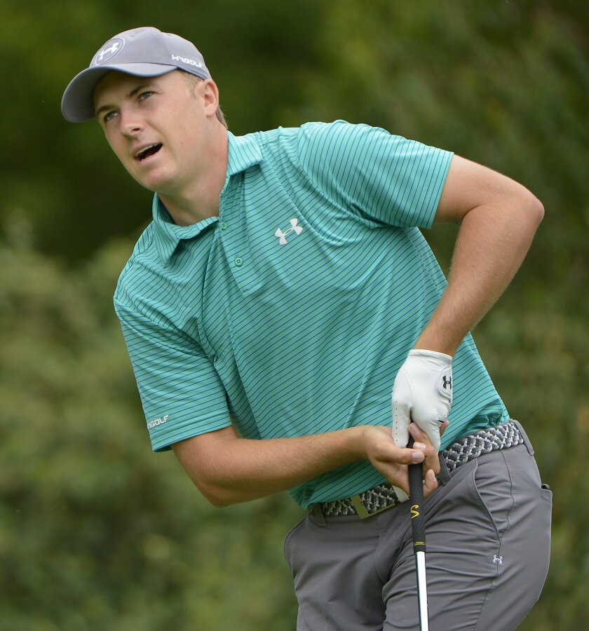 Jordan Spieth reacts to his shot from the fourth tee during the first round of the Dean & Deluca Invitational golf tournament Thursday, May 26, 2016, at Colonial Country Club in Fort Worth, Texas. (Max Faulkner/Star-Telegram via AP)