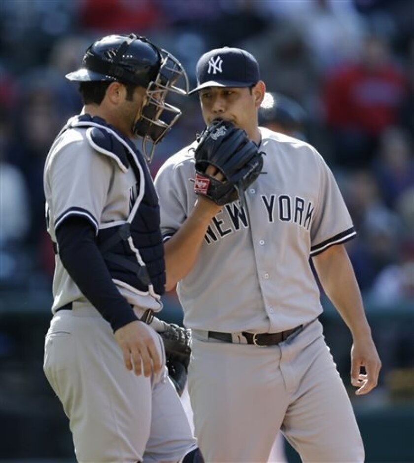 New York Yankees starting pitcher Vidal Nuno, right, talks with catcher Austin Romine in the fifth inning in the second game of a baseball doubleheader against the Cleveland Indians, Monday, May 13, 2013, in Cleveland. (AP Photo/Tony Dejak)