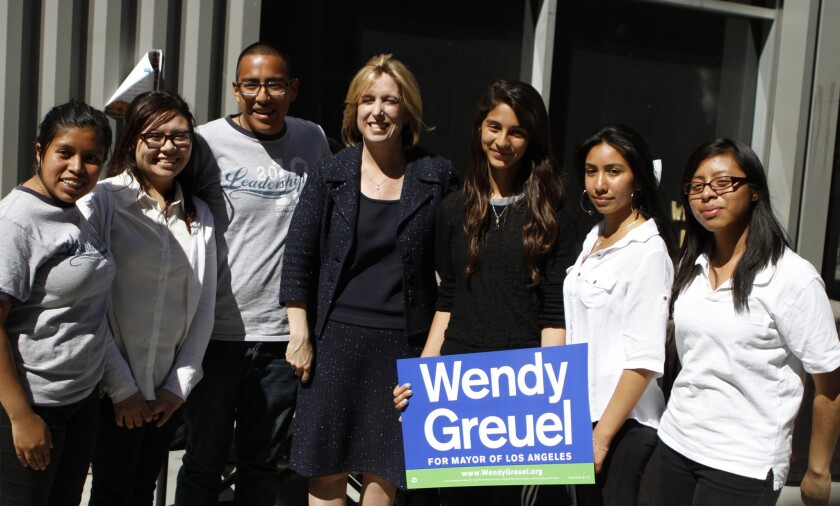 Los Angeles mayoral candidate Wendy Greuel poses for a picture with students from Camino Nuevo Charter School.