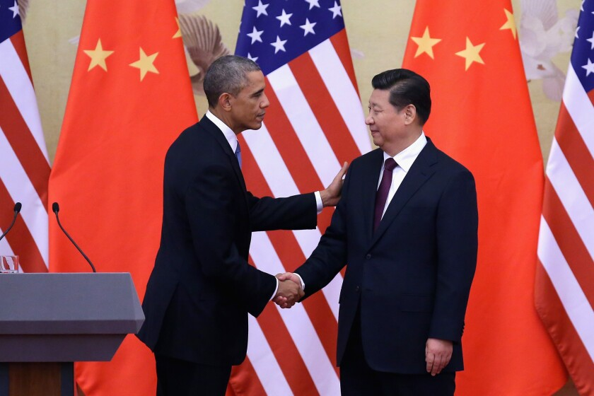 President Barack Obama shakes hands with Chinese President Xi Jinping, right, after a joint press conference at the Great Hall of People in Beijing, China.