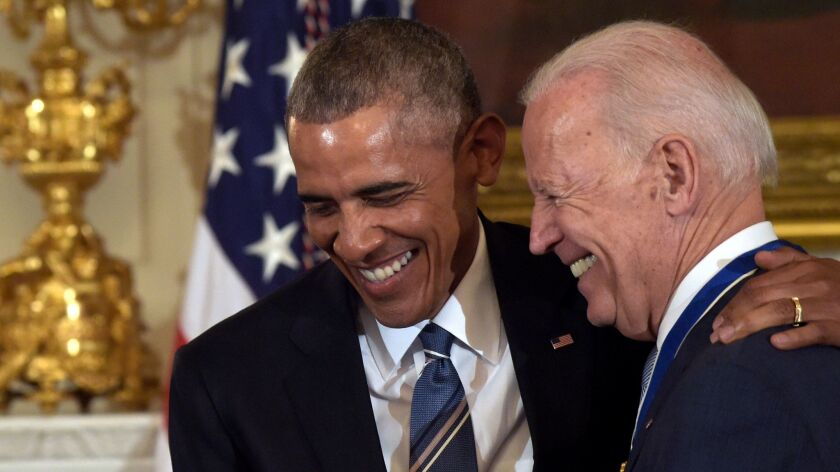 President Barack Obama laughs with Vice President Joe Biden during a ceremony in the State Dining Room of the White House in Washington on Jan. 12.