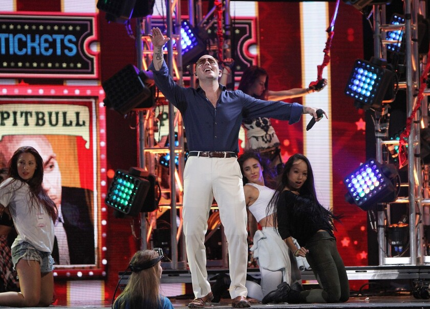 Pitbull rehearses for the 2014 Premios Juventud awards show at Miami's BankUnited Center on July 16.