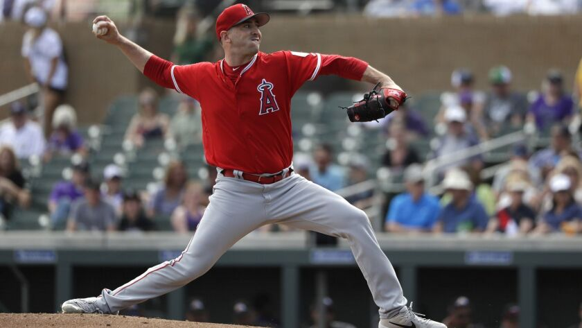 Angels starter Matt Harvey delivers during a three-inning outing against the Colorado Rockies on Wednesday in Scottsdale, Ariz.