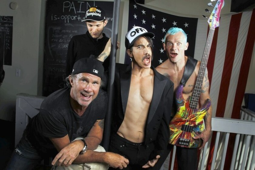 """A FRESH OUTLOOK: The Chili Peppers -- Chad Smith, left, Josh Klinghoffer, Anthony Kiedis and Flea -- have a new album, """"I'm With You,"""" due out this month."""