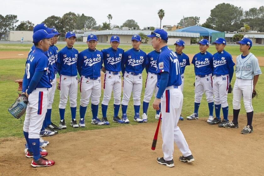 The Korean National 13U baseball team prepares for their game with the Del Mar Powerhouse baseball team.
