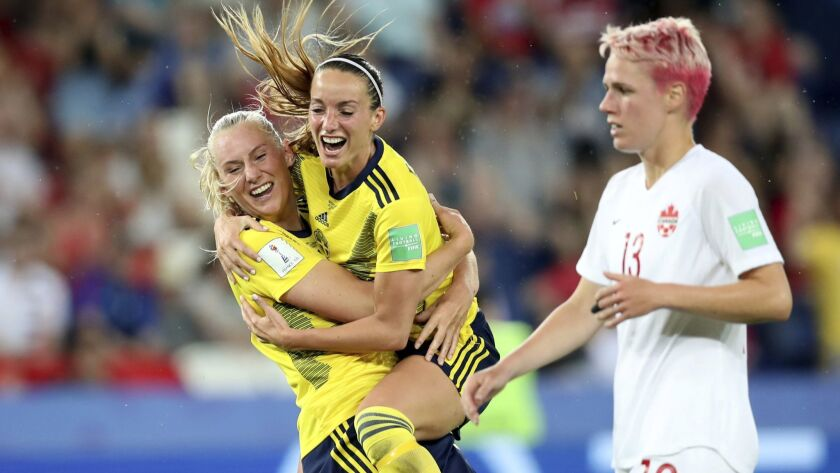 Sweden's Stina Blackstenius, left, celebrates after scoring the opening goal during the Women's Worl