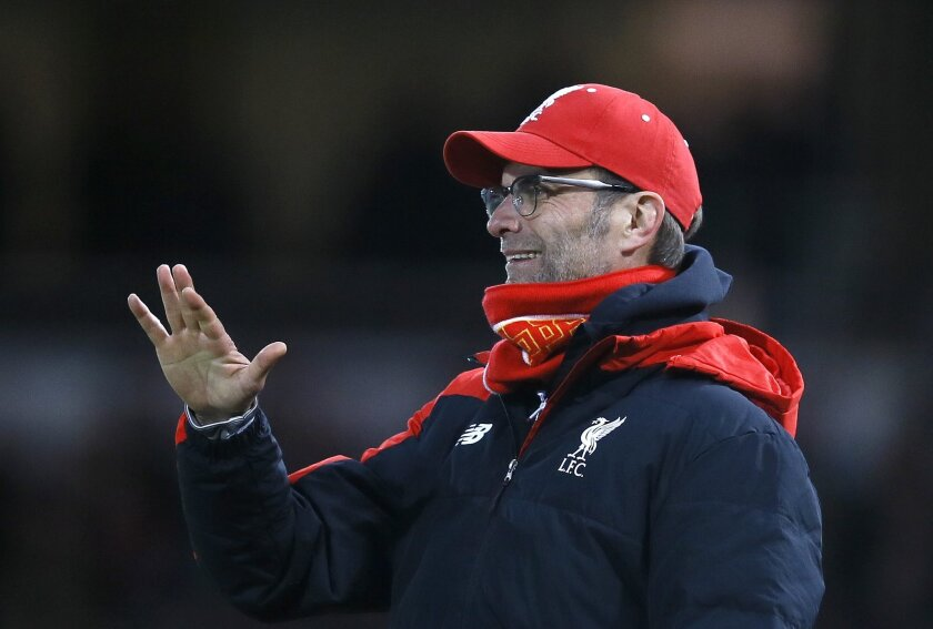 Liverpool's manager Juergen Klopp smiles during the English FA Cup fourth round replay soccer match between West Ham United and Liverpool at the Boleyn Ground stadium in London, Tuesday, Feb. 9, 2016. (AP Photo/Kirsty Wigglesworth)