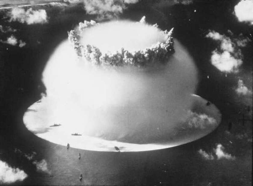 A hydrogen bomb explodes above Bikini Atoll in the Pacific Ocean in 1946.