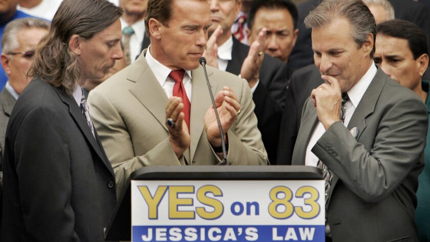 Former California Gov. Arnold Schwarzenegger appears at a 2006 Westwood news conference urging voters to support Jessica's Law, which limited where sex offenders could live. The governor was joined by Jessica's father, Mark Lunsford, left, and Marc Klass, father of kidnap victim Polly Klass.