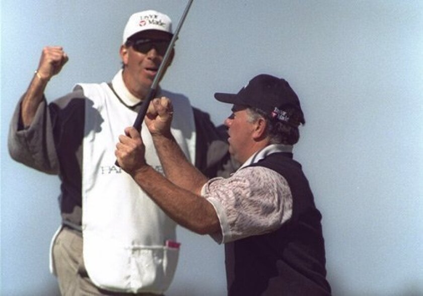 Mark O'Meara (right) celebrates with caddie Jerry Higgenbotham during the Buick Invitational in 1997.