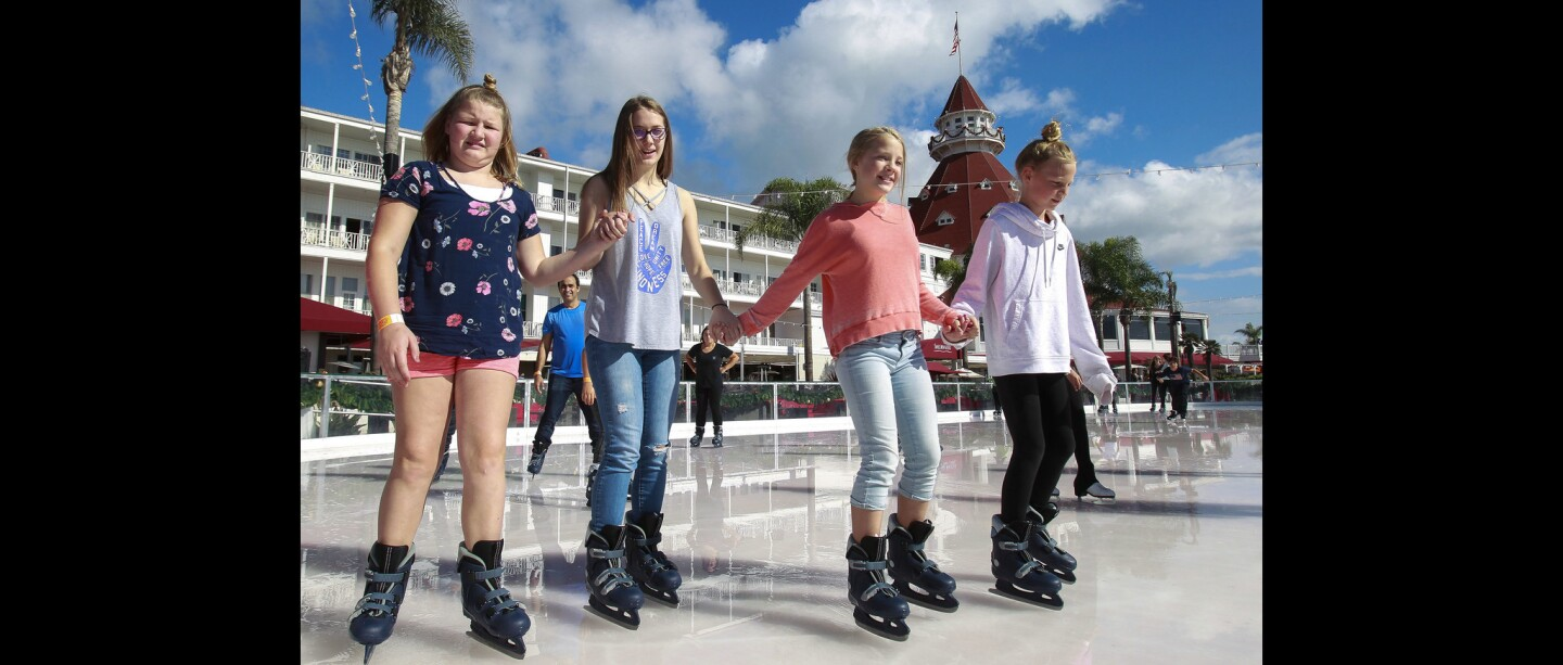 Kiah Reed, 11, left, Seren Krassett, 16, second rom left, Seren's sister Zoe Krassett, 10, and Kiah's sister Jayden Reed, 10, right, all vacationing here from Coeur d'Alene, Idaho, skate together at the Skating by the Sea ice skating rink at the Hotel Del Coronado.