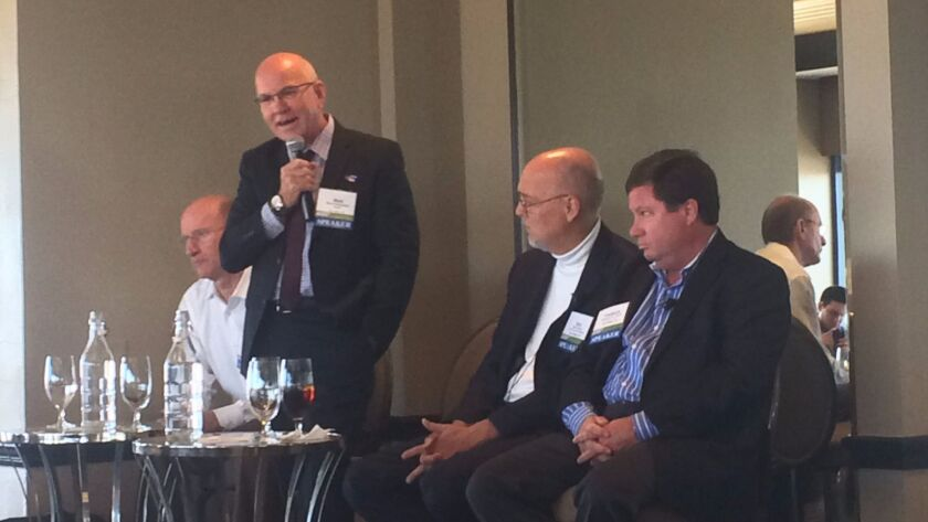 Left to right: Gary Levitt, principal at Sea Breeze Properties; Mark Cunningham, assistant vice chancellor for housing at UC San Diego; Bob Schulz, associate vice president of real estate , planning and development at SDSU; Fred Pierce, CEO of Pierce Education Properties